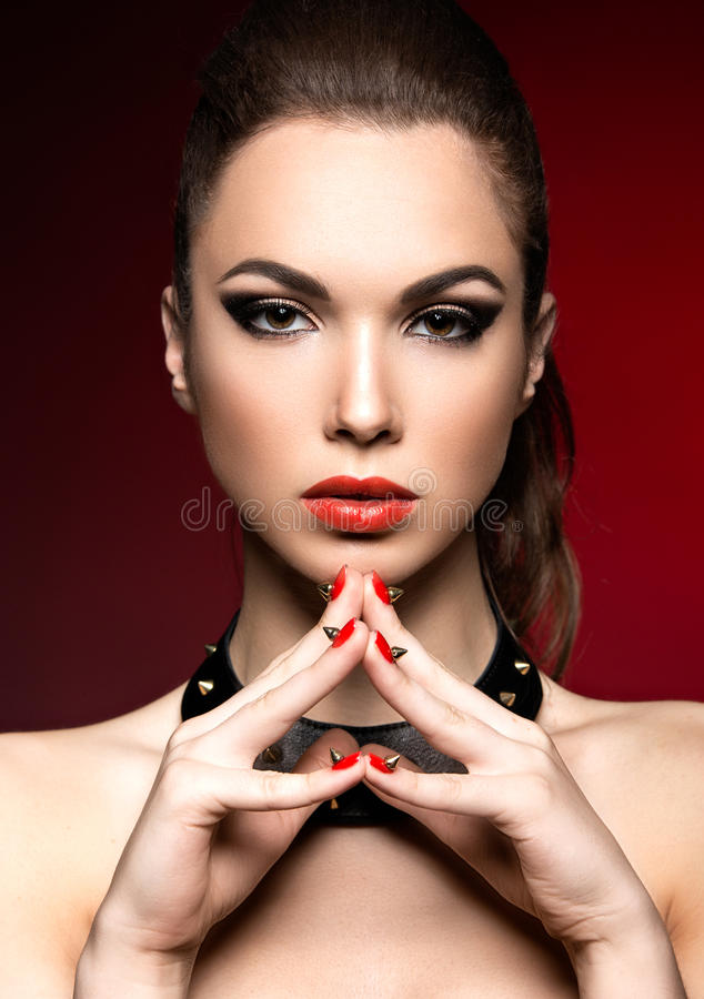 Beautiful Woman In Gothic Style With Evening Makeup And Red Nails Thorns Picture Taken A Studio On Background