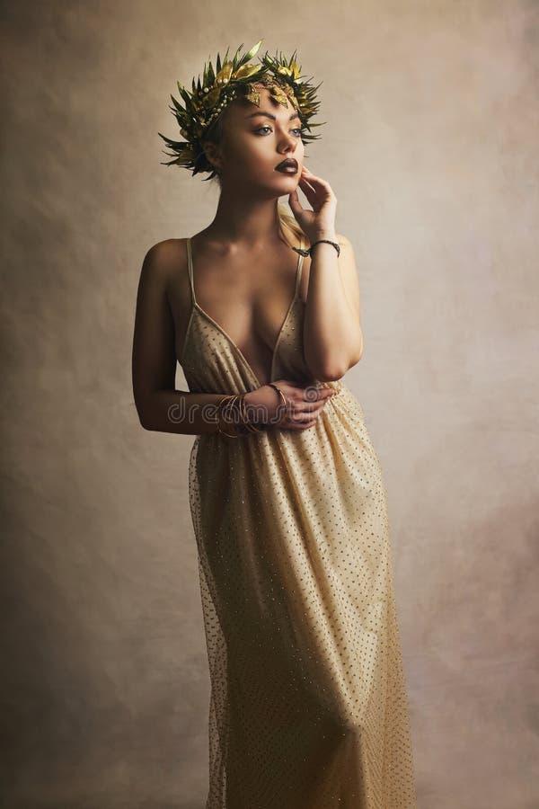 Woman in greek greece goddes dress. Beautiful woman in greek greece goddes dress and wreath high fashion stock photography