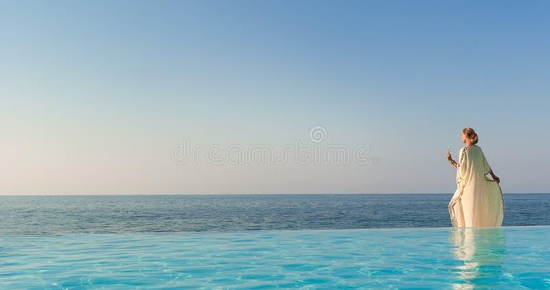 Download Beautiful Woman In Greek Style On Infinity Pool Stock Image - Image: 22982745