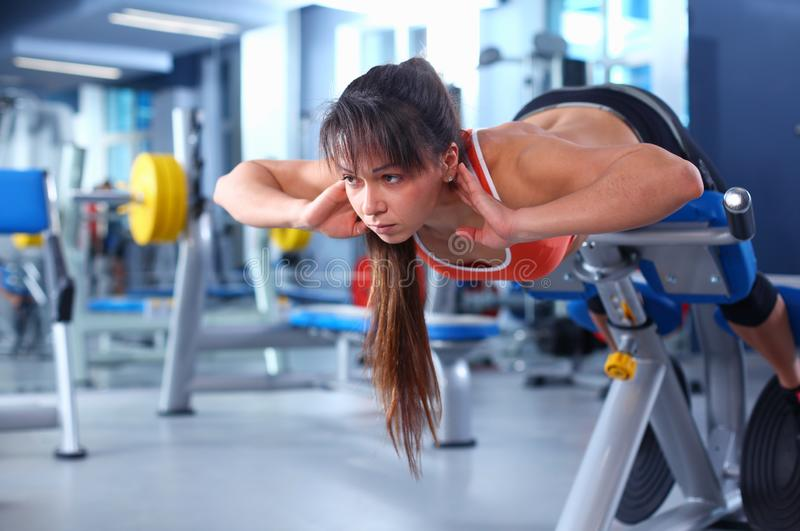 Beautiful woman at the gym exercising with her trainer . Beautiful woman. royalty free stock photography