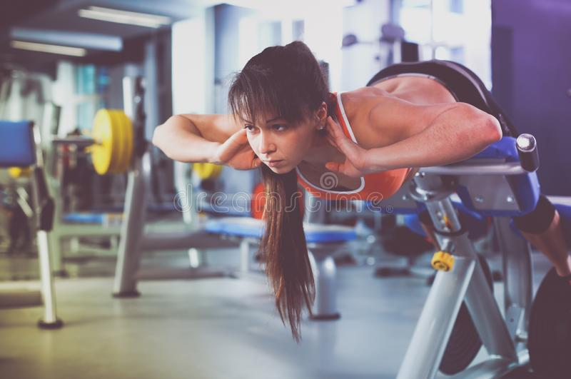 Beautiful woman at the gym exercising with her trainer . Beautiful woman. royalty free stock photo