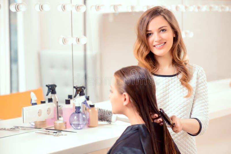 Beautiful woman in hair salon stock photography
