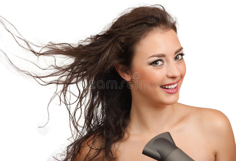 Beautiful woman with hairdryer stock photos