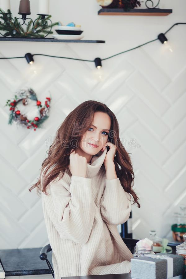 Woman in a decorated christmas apartment stock images