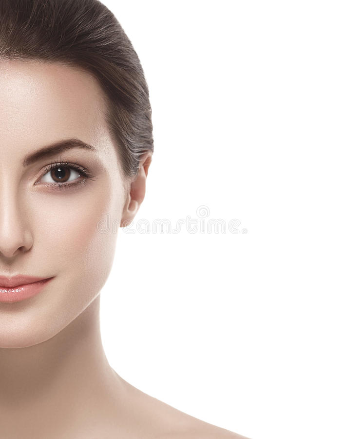 Beautiful woman half face close up studio on white. Beautiful woman half face close up studio isolated on white royalty free stock images