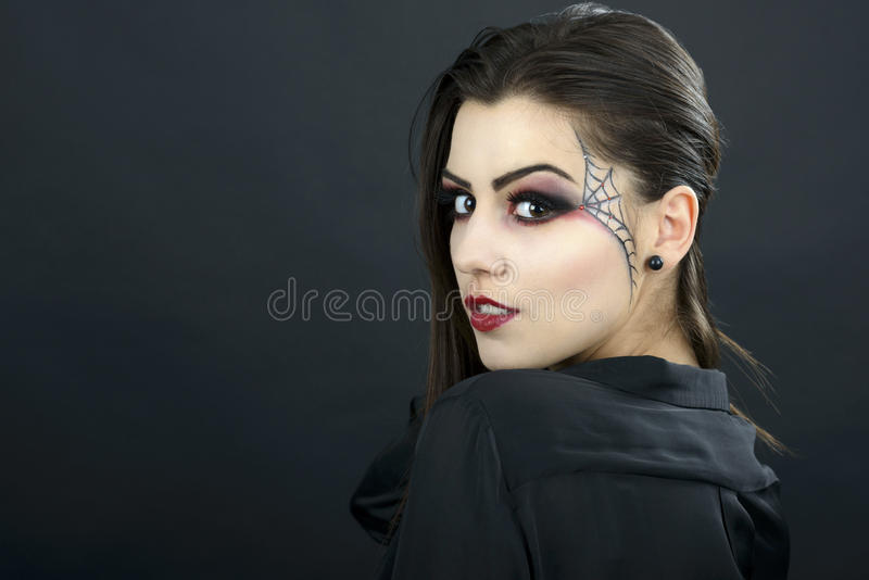 Beautiful woman with halloween makeup isolated on black background royalty free stock images