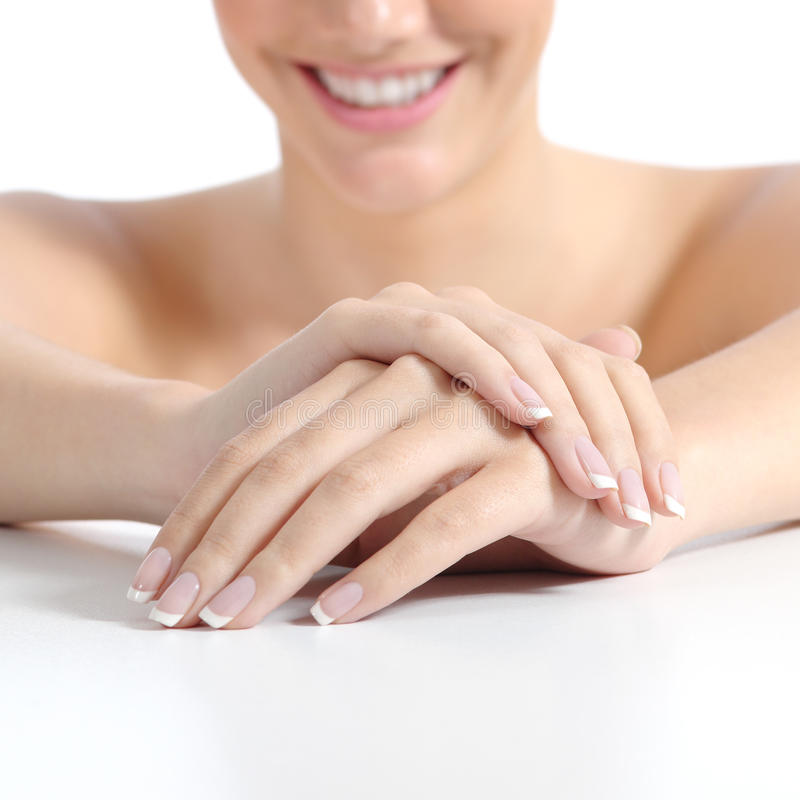 Beautiful woman hands nails with perfect french manicure. Isolated on a white background