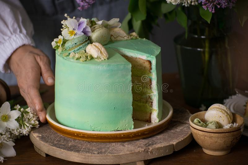 Beautiful woman hands with peace of beautiful green cake and flo royalty free stock photos