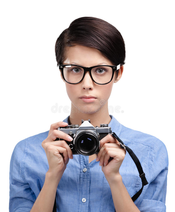 Beautiful woman hands retro photographic camera. Beautiful woman in spectacles hands retro photographic camera, isolated on white royalty free stock photo