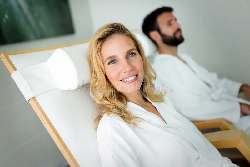 Beautiful woman with handsome man relaxing in spa. Beautiful women in bathrobe with handsome men relaxing in spa stock image