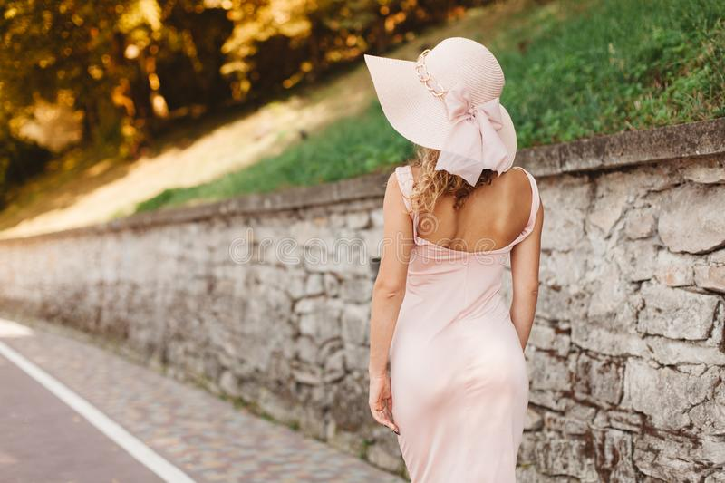 Beautiful woman in hat. Back view stock images
