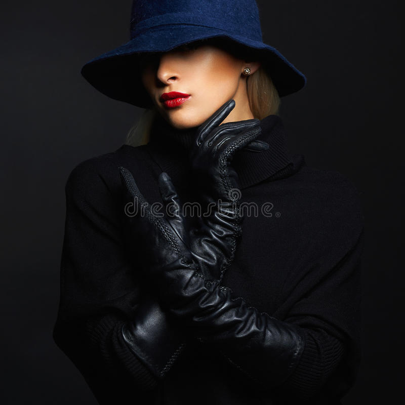 Beautiful woman in hat and leather gloves. Retro fashion girl stock images