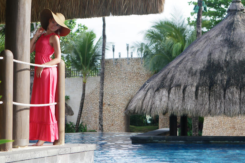 Download Beautiful Woman In Hat Relaxing Near Pool Stock Image - Image: 28606921