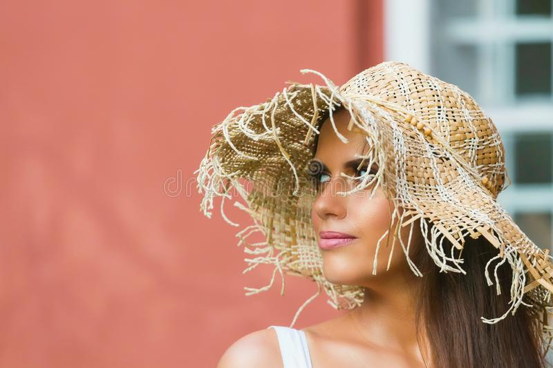 Beautiful woman in hat summer day outdoors. Fashion and lifestyle concept. Beautiful brunette stock photos