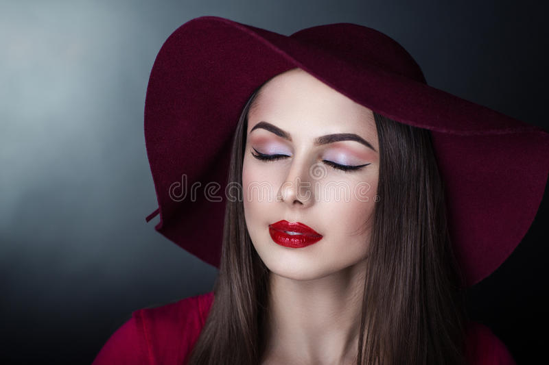 Beautiful woman in hat stock images