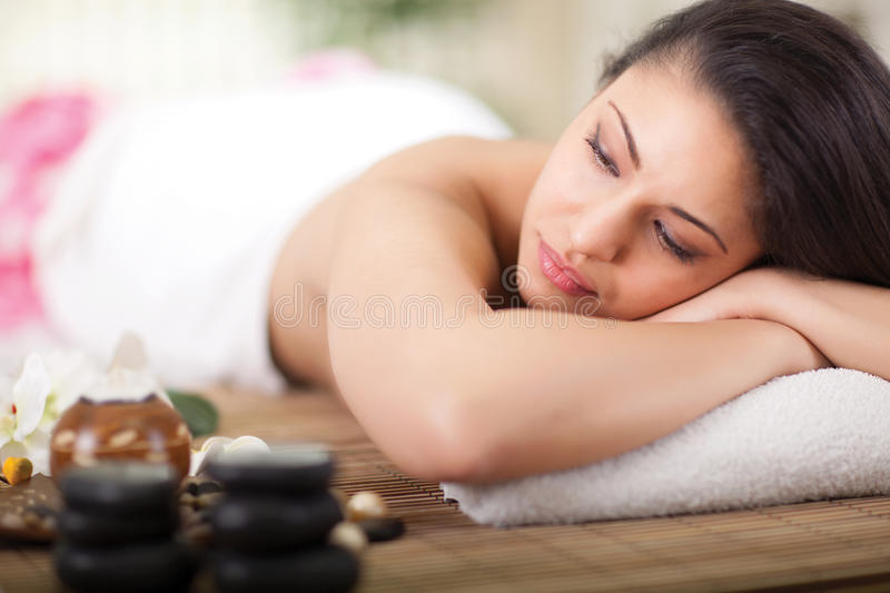 Beautiful woman having beauty treatments in the spa salon stock image