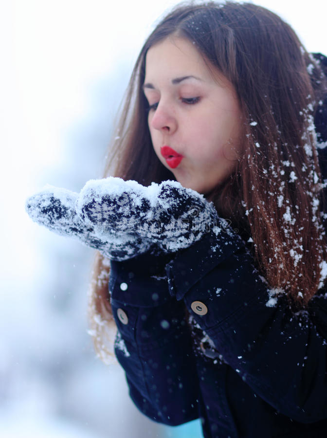 Beautiful woman having fun in winter royalty free stock photography