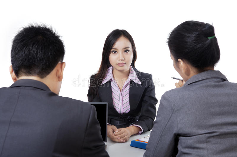 Beautiful woman having an interview stock photo
