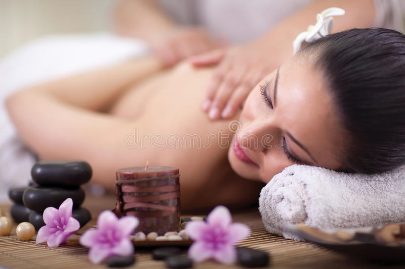 Beautiful woman having a wellness back massage at spa salon royalty free stock photography