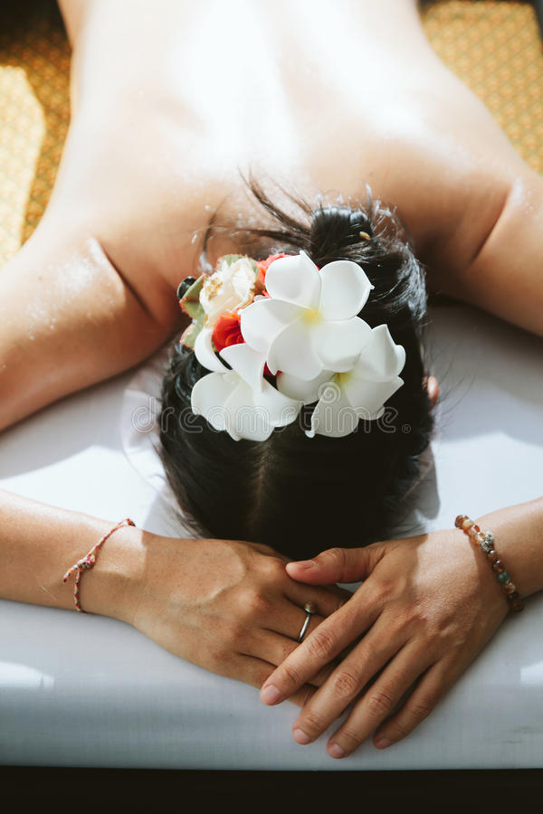 Beautiful woman having a wellness back massage. royalty free stock image