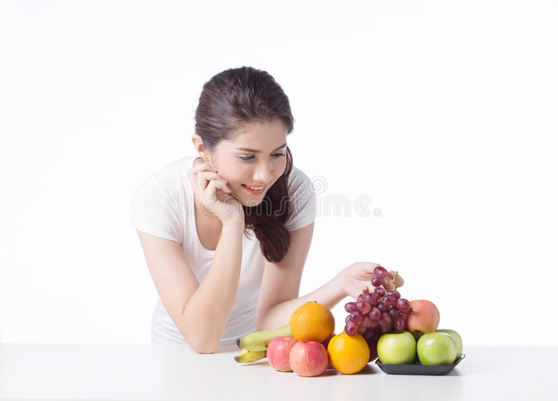 Beautiful woman with healthy food, white background. Isolate stock photo