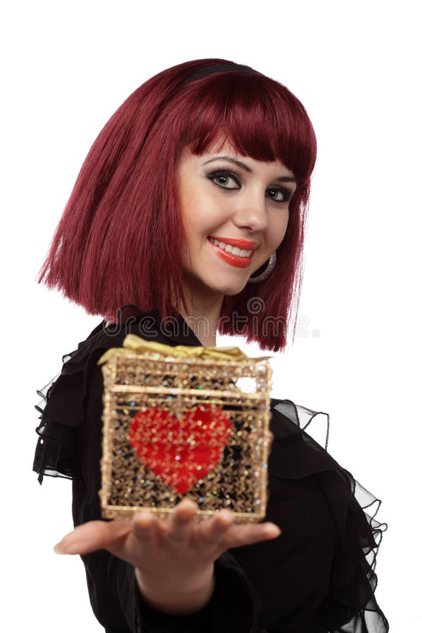 Beautiful woman with heart packed in a gift box royalty free stock images