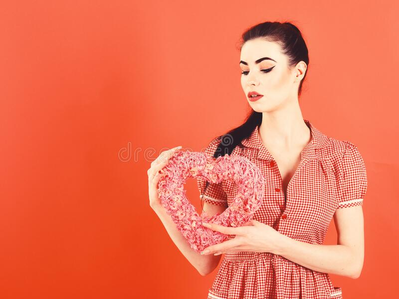 Beautiful woman with heart on red background royalty free stock photo