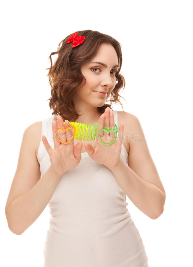 Beautiful woman with heart shaped toys royalty free stock photography
