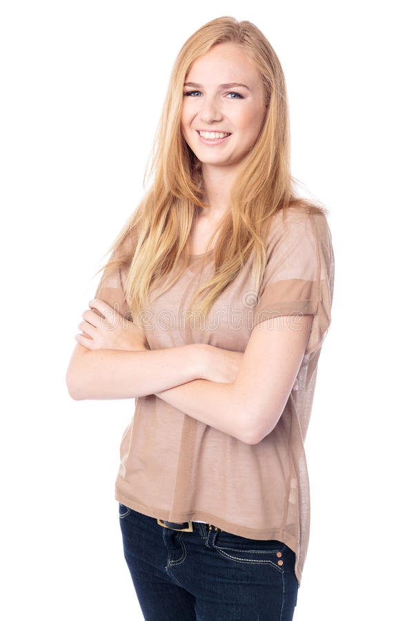 Beautiful woman with her arms folded. Beautiful blond woman with her arms folded standing at an angle smiling at the camera with a lovely smile, isolated on stock photography