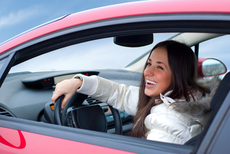 Beautiful woman in her car royalty free stock photography