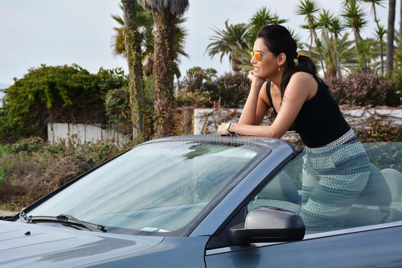 Beautiful woman in her convertible royalty free stock photo