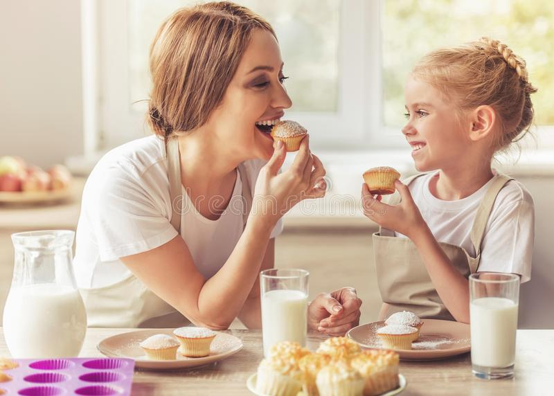 Beautiful Woman and Her Cute Little Daughter stock images