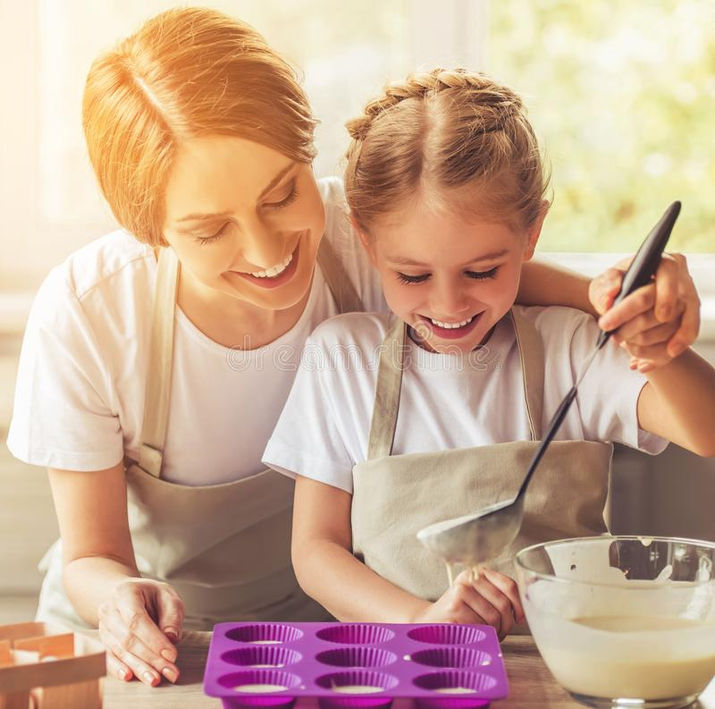 Beautiful Woman and Her Cute Little Daughter royalty free stock photos