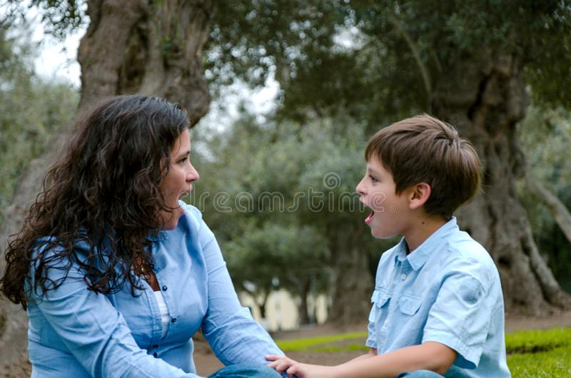 Beautiful woman and her cute little son looking to each other amazed royalty free stock images