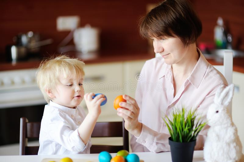 Beautiful woman and her cute son or grandson playing with easter egg on Easter day stock images