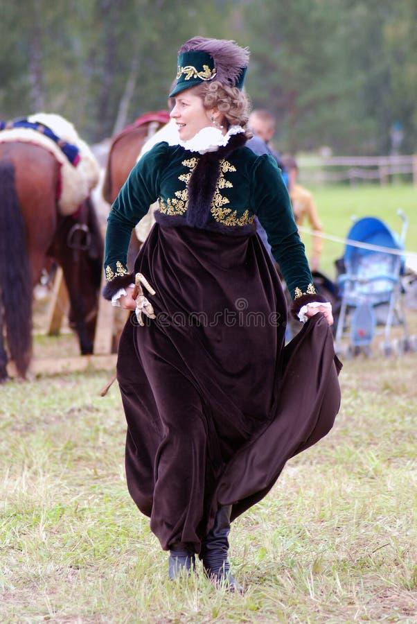 Beautiful woman in historic dress at Borodino historical reenactment in Russia. BORODINO, MOSCOW REGION - SEPTEMBER 04, 2016: Beautiful woman in historic dress stock photos