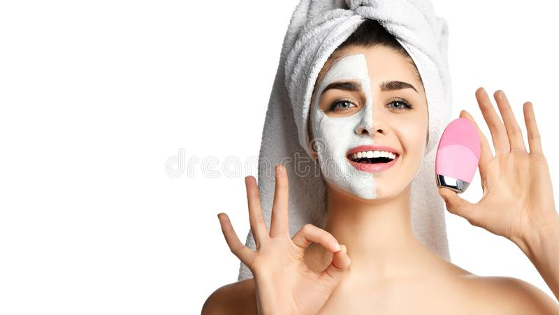 Beautiful woman hold pink face exfoliator brush silicone cleansing device for sensitive normal skin show ok sign. Isolated on white background stock photo