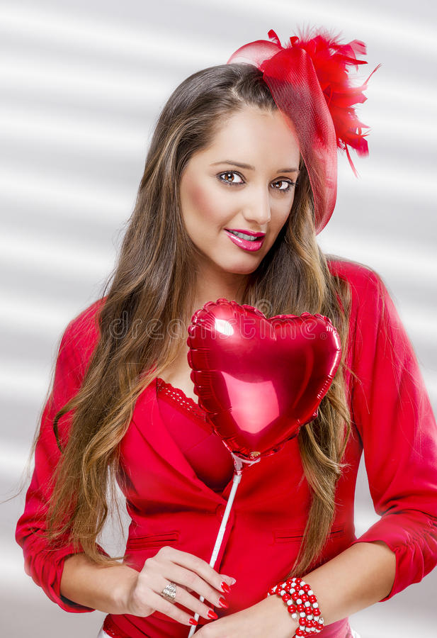 Beautiful woman holding balloon stock photos