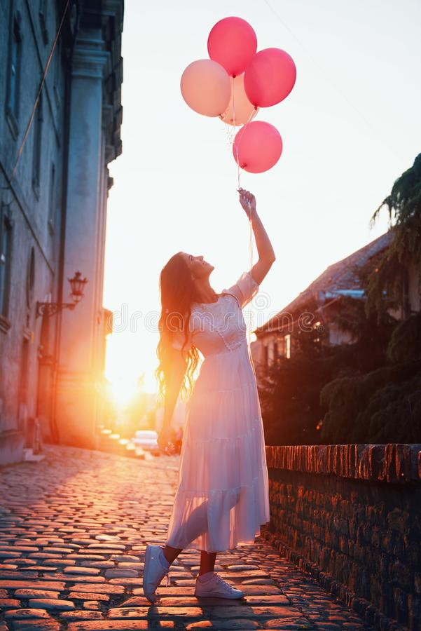 Beautiful woman holding balloons outdoors royalty free stock image