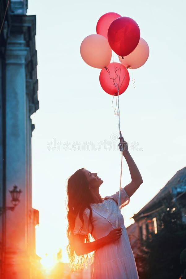 Beautiful woman holding balloons outdoors royalty free stock photos