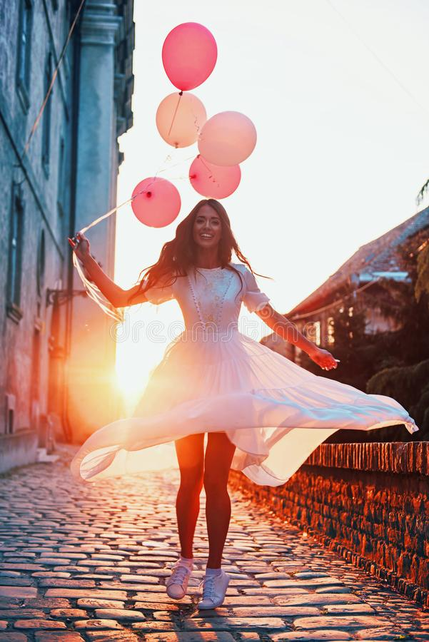 Beautiful woman holding balloons outdoors stock images