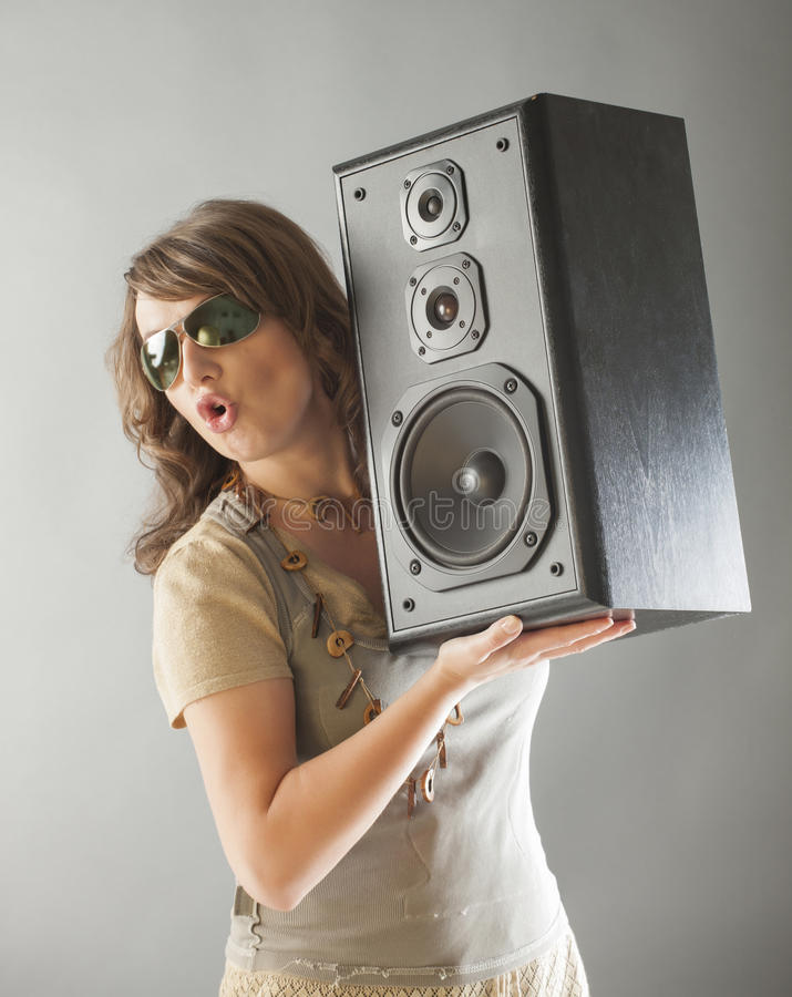 Beautiful woman holding big wooden speaker royalty free stock photos