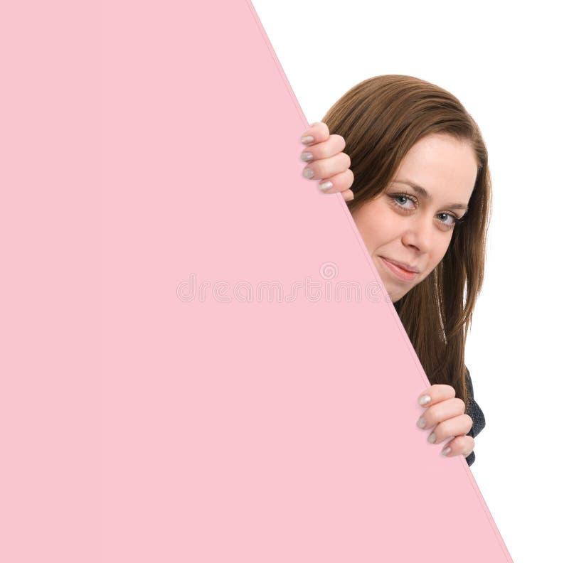 Beautiful woman holding a blank billboard royalty free stock photo
