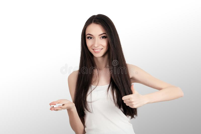 Beautiful Woman Holding Broken Cigarette. Quitting Cigarettes.  stock photos