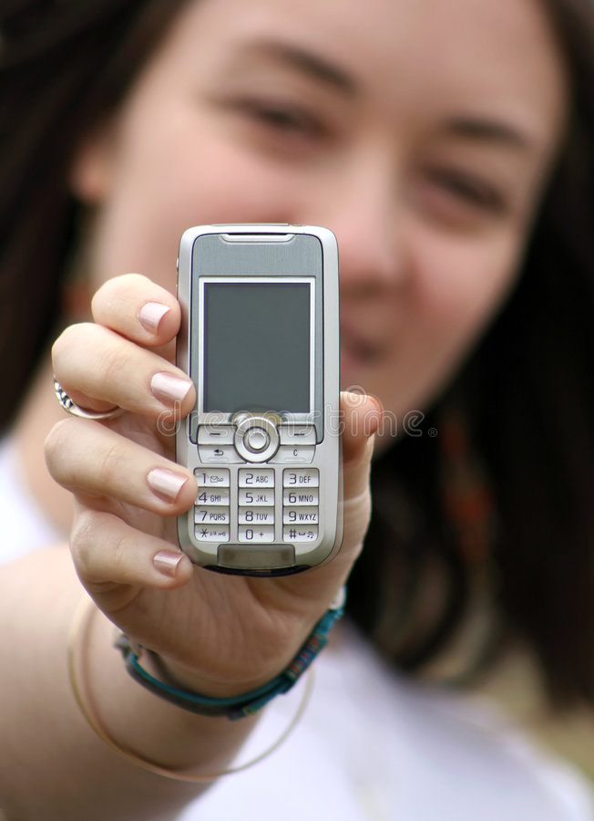 Download Beautiful Woman Holding A Cell Phone Stock Photo - Image: 169592