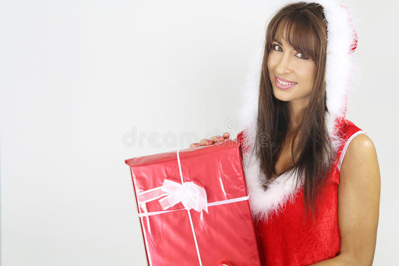 Beautiful woman holding a Christmas present stock images