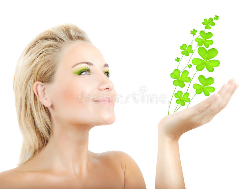Beautiful woman holding clover leaves stock photos