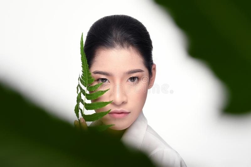 Beautiful woman holding green plant royalty free stock photography