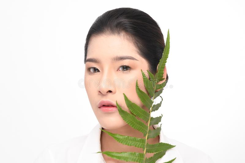 Beautiful woman holding green plant royalty free stock image