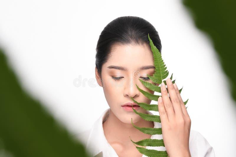 Beautiful woman holding green plant stock image